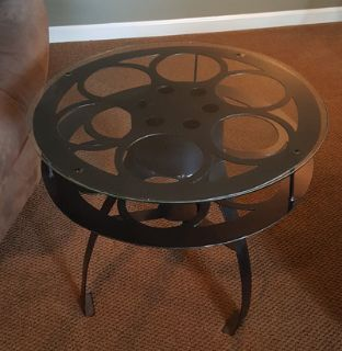 2 reel End tables, 1 film coffee table base and huge popcorn wall art.