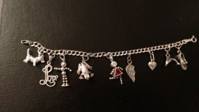 Sterling silver charm bracelet w/ 9 charms