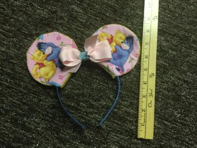 Custom made, Disney Winnie the Pooh Ears in GUC with normal light wear from normal use $3.00