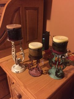 Metal candle holders with candles.