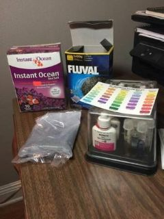 Fish tank supplies: water testing kit, Fluval carbon filter, box if instant ocean
