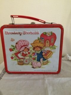 8 x 7 in old vintage tin Strawberry Shortcake lunch kit with thermos has some scratches $15