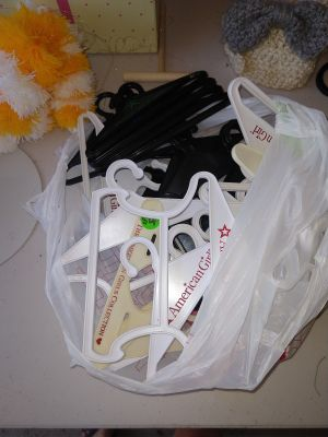 Bag of American Girl hangers.