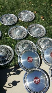 about 20 older cadillac hubcaps. Very cool.