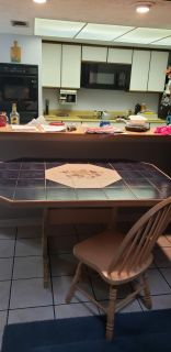 Tile top dining room table with 5 chairs