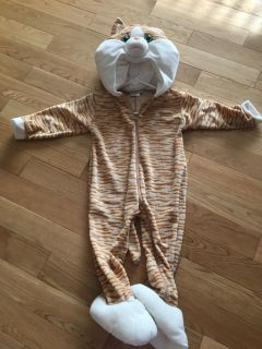 Halloween kitty cat costume. Size XXS. Measures 30 from shoulder to ankle. Fits 3-4 yr old