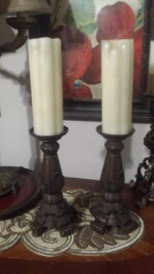pair of candle holders with candles