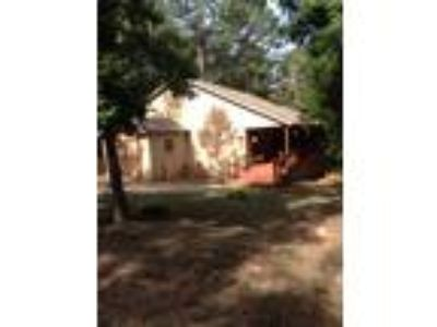 Three BR/Two BA/1844 SF home in Immaculate condition on a wooded corner lot!