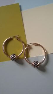 Beautiful gold hoops with sapphire ball detail.