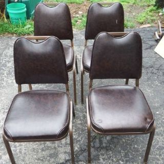 4 STACKABLE BROWN VINYL AND METAL KITCHEN CHAIRS