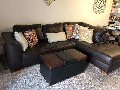 Sectional couch with coffee table and pillows