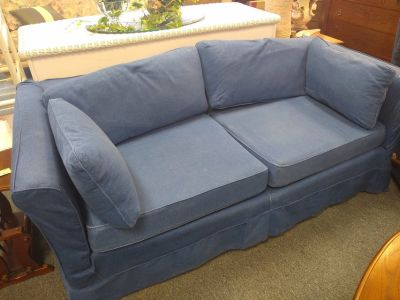 Blue denim covered sofa