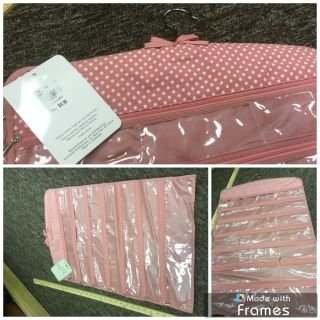 Brand NEW with tags, hanging double sided jewelry organizer, $3.00 says retails $9.99.