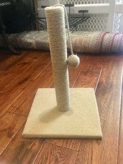 Cat scratching post w/hanging ball toy.