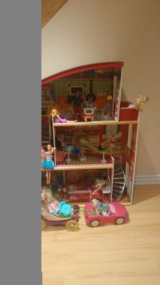 KidKraft Doll house with Barbies, Furniture and Barbie car