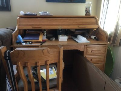 Solid wood roll top desk.