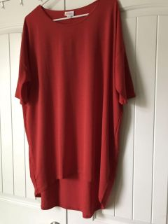 Lularoe top. True red color. Size Large.