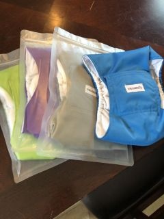 Belly bands/puppy diapers for male dogs, size L. Set of 4, 3 are unopened.