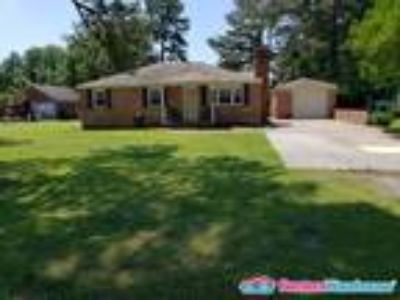 Beautifully Remodeled Four BR Home!