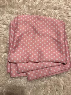 Pink and white polka dot curtain panel