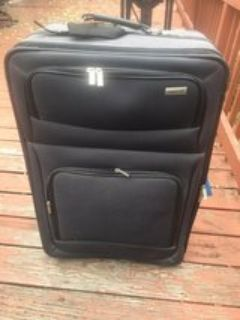 LARGE ROLLING SUIT CASE