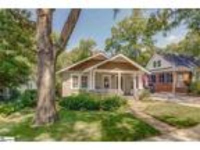 Adorable bungalow with rocking chair front po...