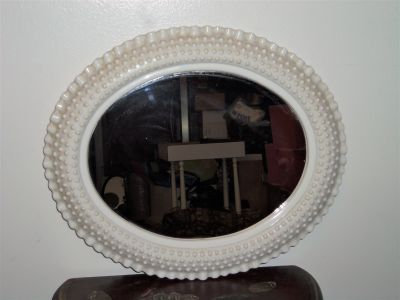 nice mirror, plastic but looks like milk glass (needs to be cleaned)