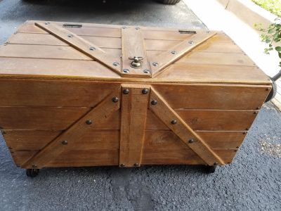 Decorative wooden chest on wheels / coffee table
