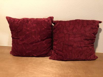 Two dark red decorative pillows. New like. Smoke free home. No cats.