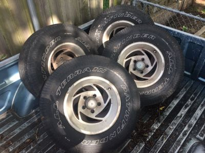 Tires and rims. Tires worn. Chevrolet 5 hole wide rims.
