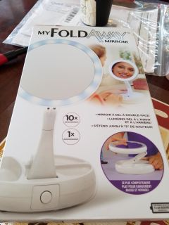 Fold away mirror ...brand new never taken outta box .. sells for 20...am asking 15 firm