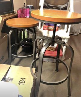 PAIR OF INDUSTRIAL WOOD AND IRON BAR STOOLS - ADJUSTABLE
