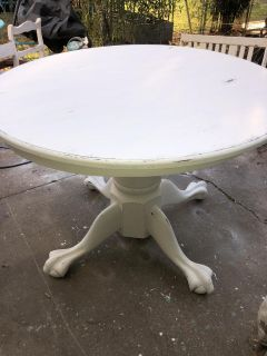 Table. Round distressed claw foot table