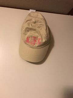 Hat with initials M K F.