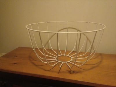 Large metal basket plastic cpating chipped in a small area as shown