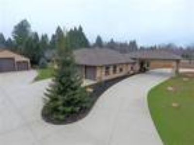 Custom 1-story home on 1.6 acre lot with 14 car garage spaces!