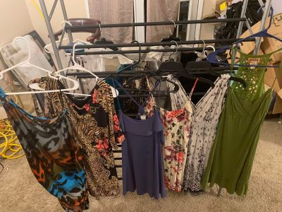 Lot of ladies dresses, tops and rompers