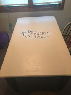 Very solid and sturdy dining/kitchen table with 6 chairs.