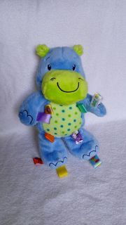 Taggies plush hippo. Has a rattle in the belly and a beanbag bottom. Excellent, clean condition