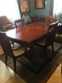 Formal dining set 6 chairs 1 leave has a few scratches on chairs easily fixed