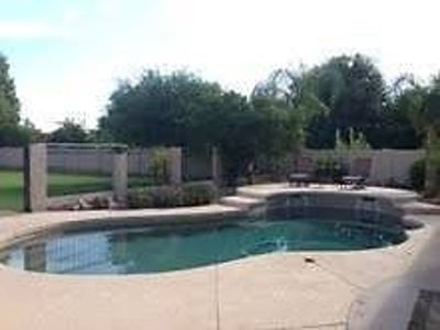 House with spacious yard, Pool, theatre, 3 car garage and bar!
