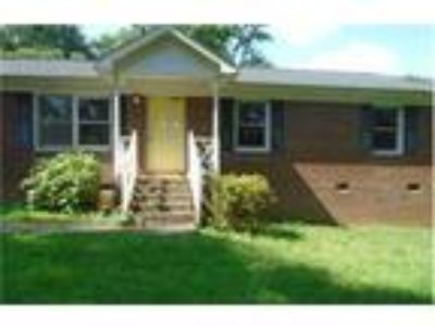 Priced to Sell!! Brick ranch with an attached 1 car carport