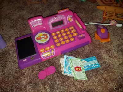 Active, talking cash register with money and credit card