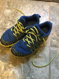 Inov trail tennis shoes. Toes are a little scuffed but otherwise great condition. Light weight and flexible and good grip soles. Size 2