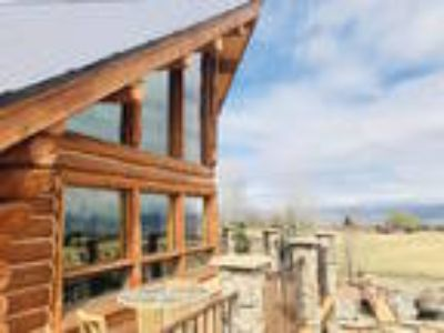 STUNNING Custom Log Home on 29+ Acres! Private setting!