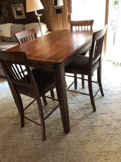 Beautiful solid wood counter height dining table and four upholstered chairs