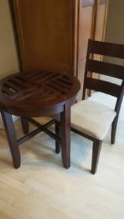 partial dining table and 3 chairs