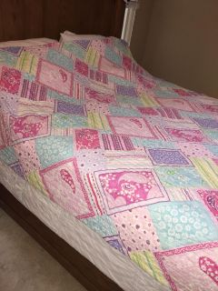 Quilt/Shown on a Queen bed but fits better on a full.