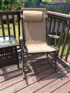Never been used rocking patio chair. It can be folded flat for storage in winter