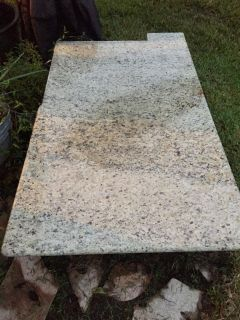 Pieces of Venetian Gold granite...has bullnose on some sides. Would be great for outdoor kitchen or projects